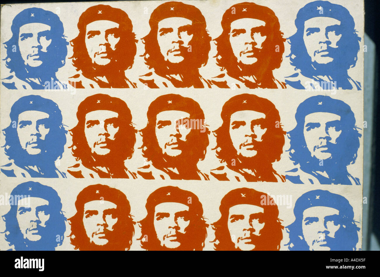 Repetition of che guevara portrait in red and blue on a wall in Havana, Cuba - Stock Image