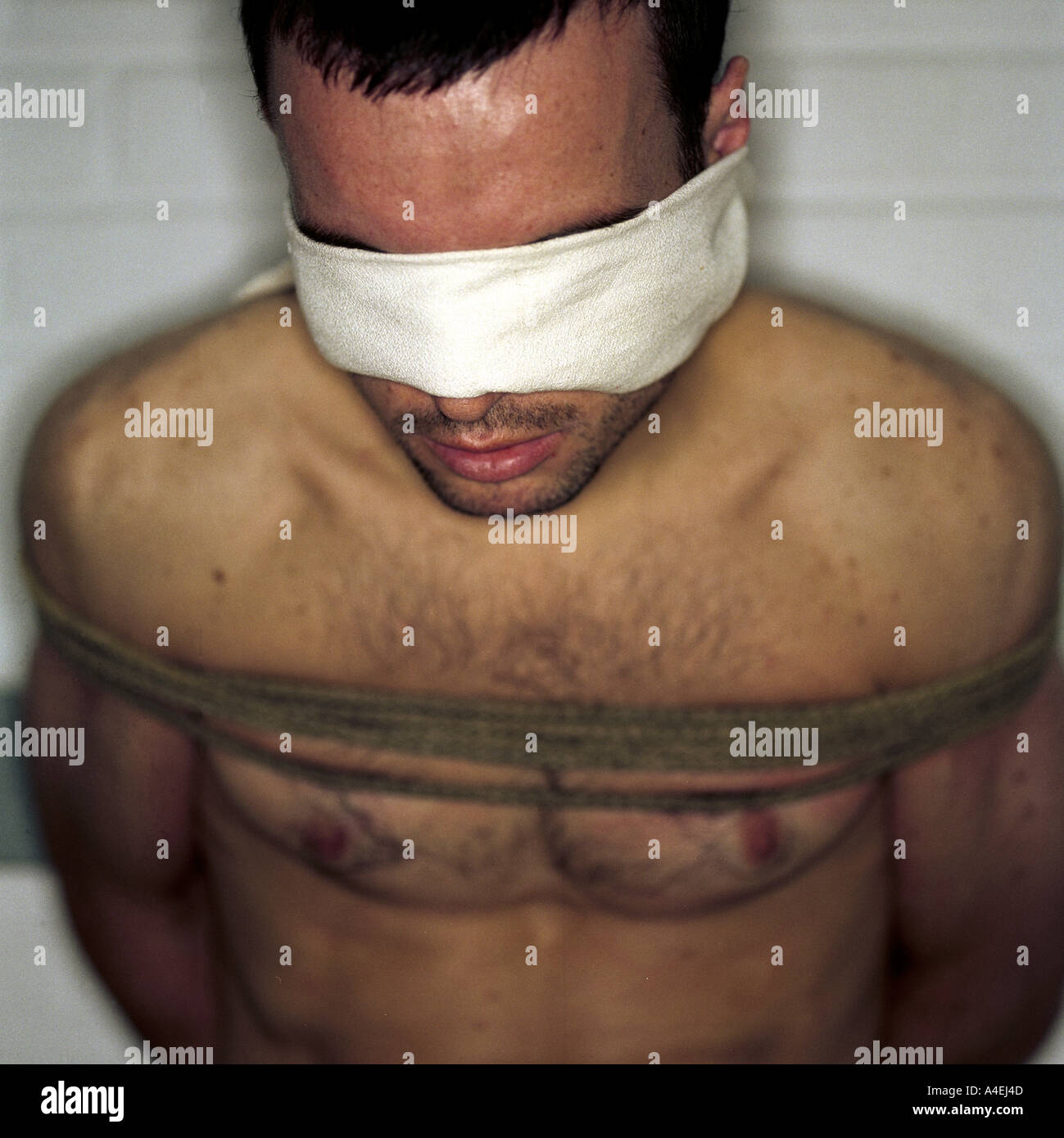 interrogation and torture posed by model - Stock Image
