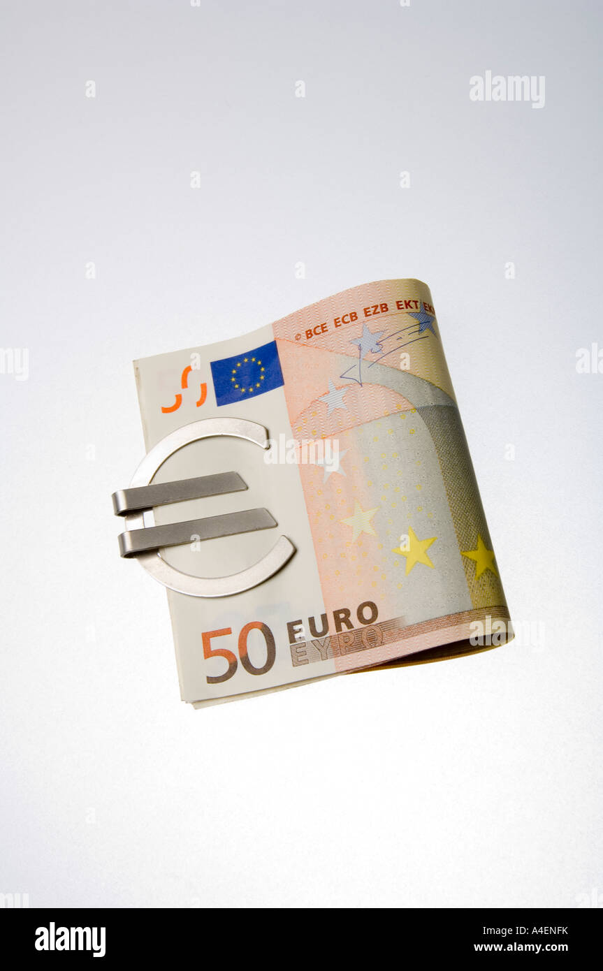 A money clip in the form of a Euro symbol holding 50 Euro banknotes - Stock Image