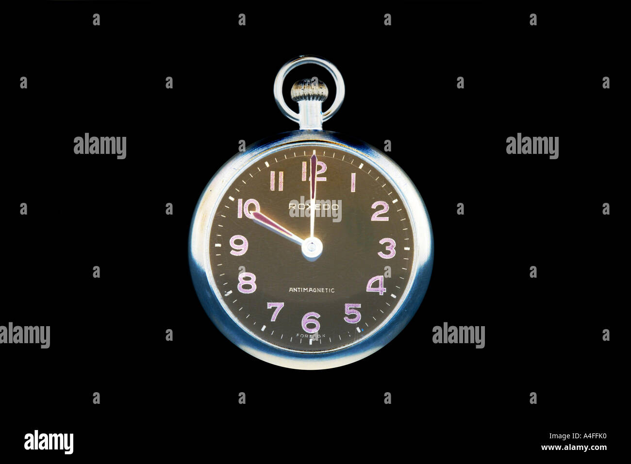Pocketwatch at 10 o'clock against a black background. - Stock Image