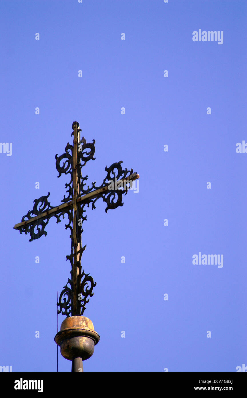 Brass medieval cross at the top of church spire tower, Banska Bystrica - Stock Image