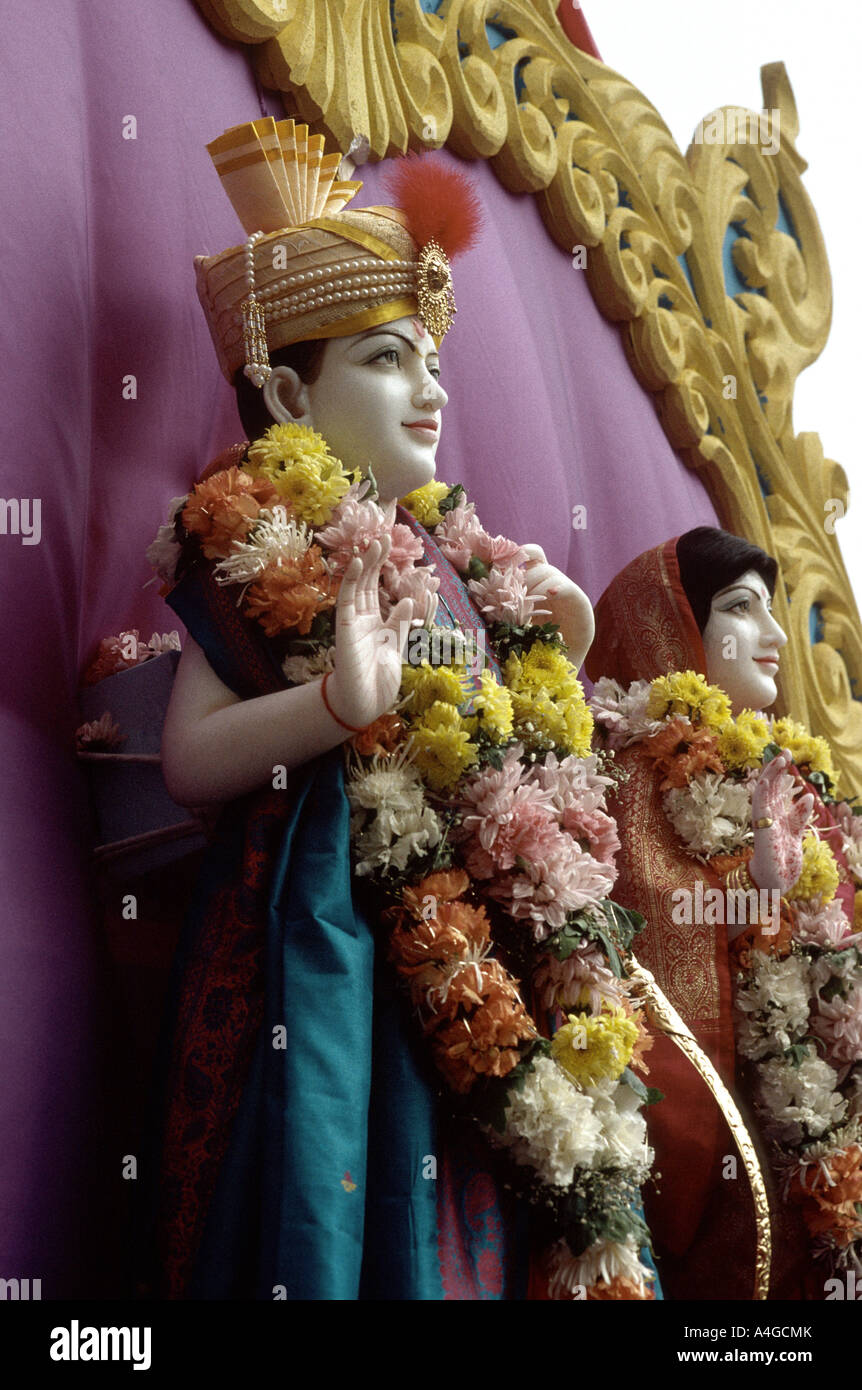 Model images of the god and goddess Lord Rama with wife Sita presented on a float in a Hindu outdoor celebration - Stock Image