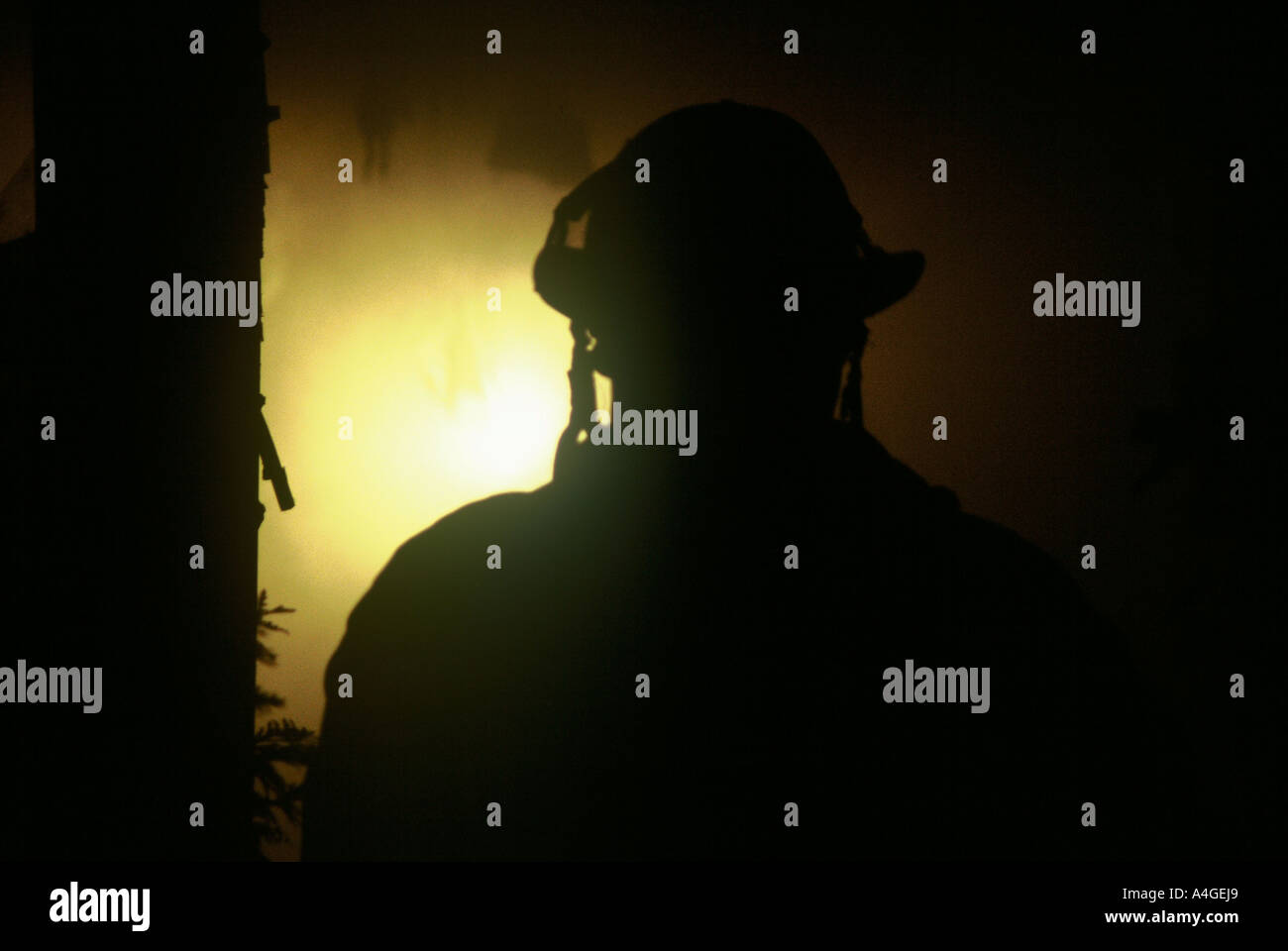 Life In Dark Holes Stock Photos Images Onefire Clover Night Lamp A Fire Fighter Silhouetted With Helmet Smoke And Light At Scene