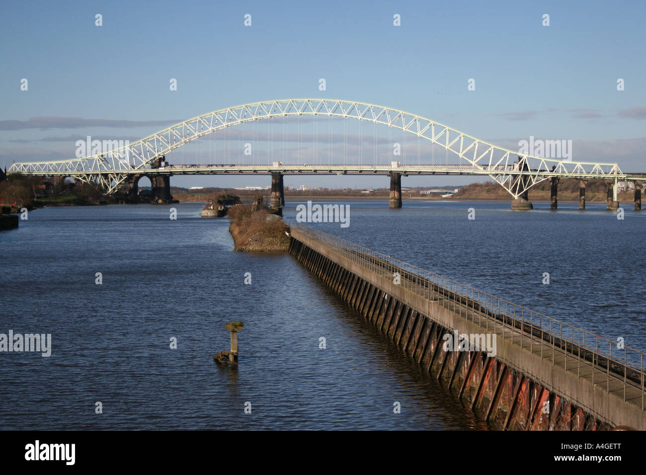 The old Silver Jubilee Bridge over the River Mersey and Manchester Ship Canal between Runcorn & Widnes, Cheshire, - Stock Image