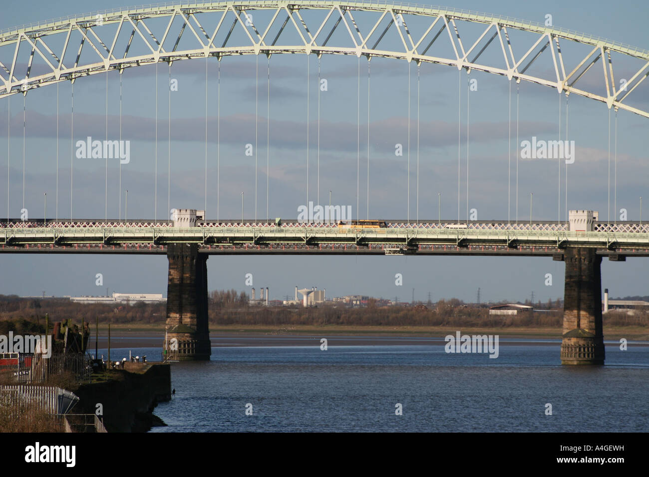The old Silver Jubilee Bridge over the River Mersey and Manchester Ship Canal between Runcorn & Widnes, Cheshire, Stock Photo