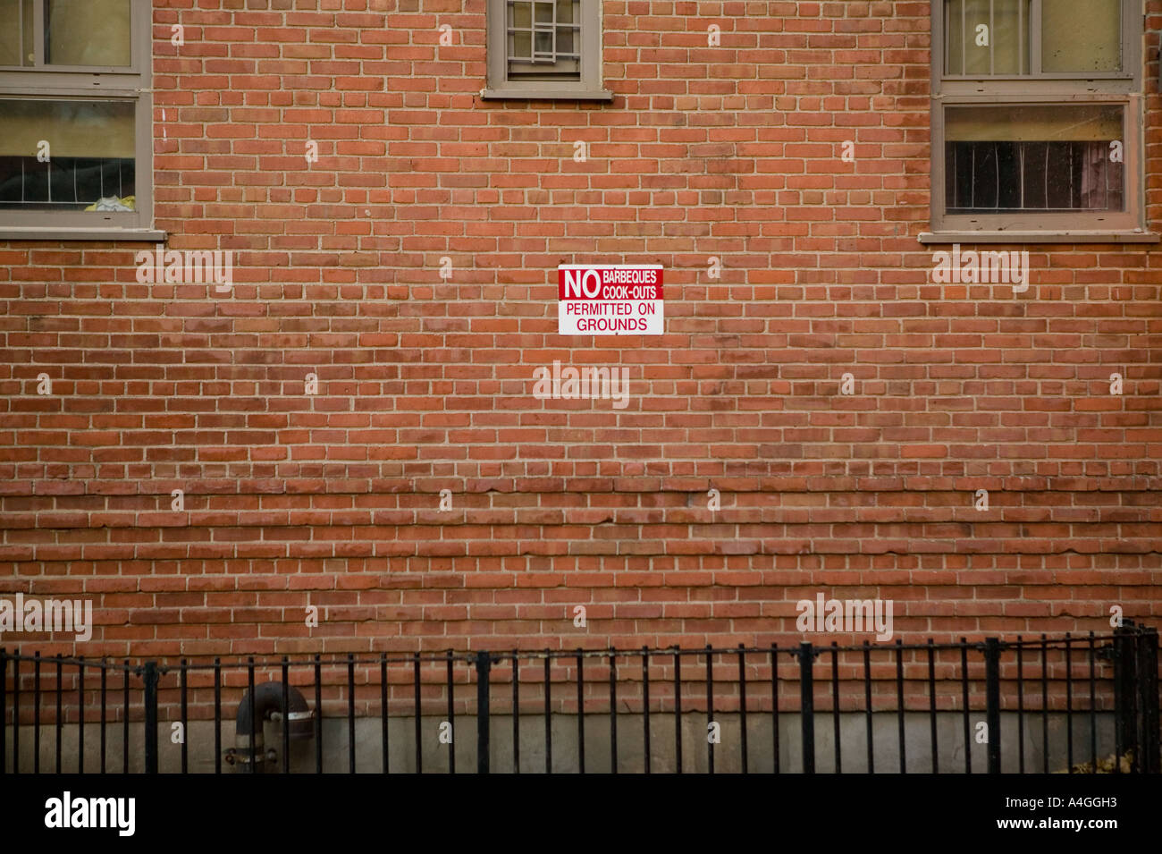 A sign on a wall in uptown new york city reads No Barbecues Cook Outs Permitted On Grounds usa november 2004 - Stock Image