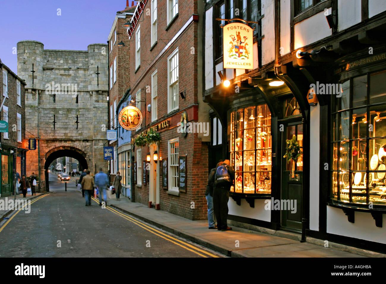 york england uk bootham bar and shops at christmas at dusk stock