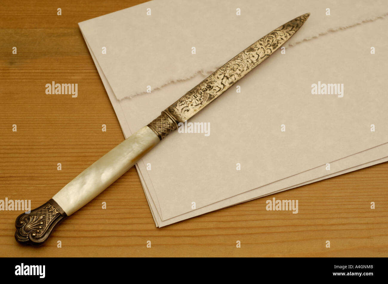 antique letter opener and stationary - Stock Image