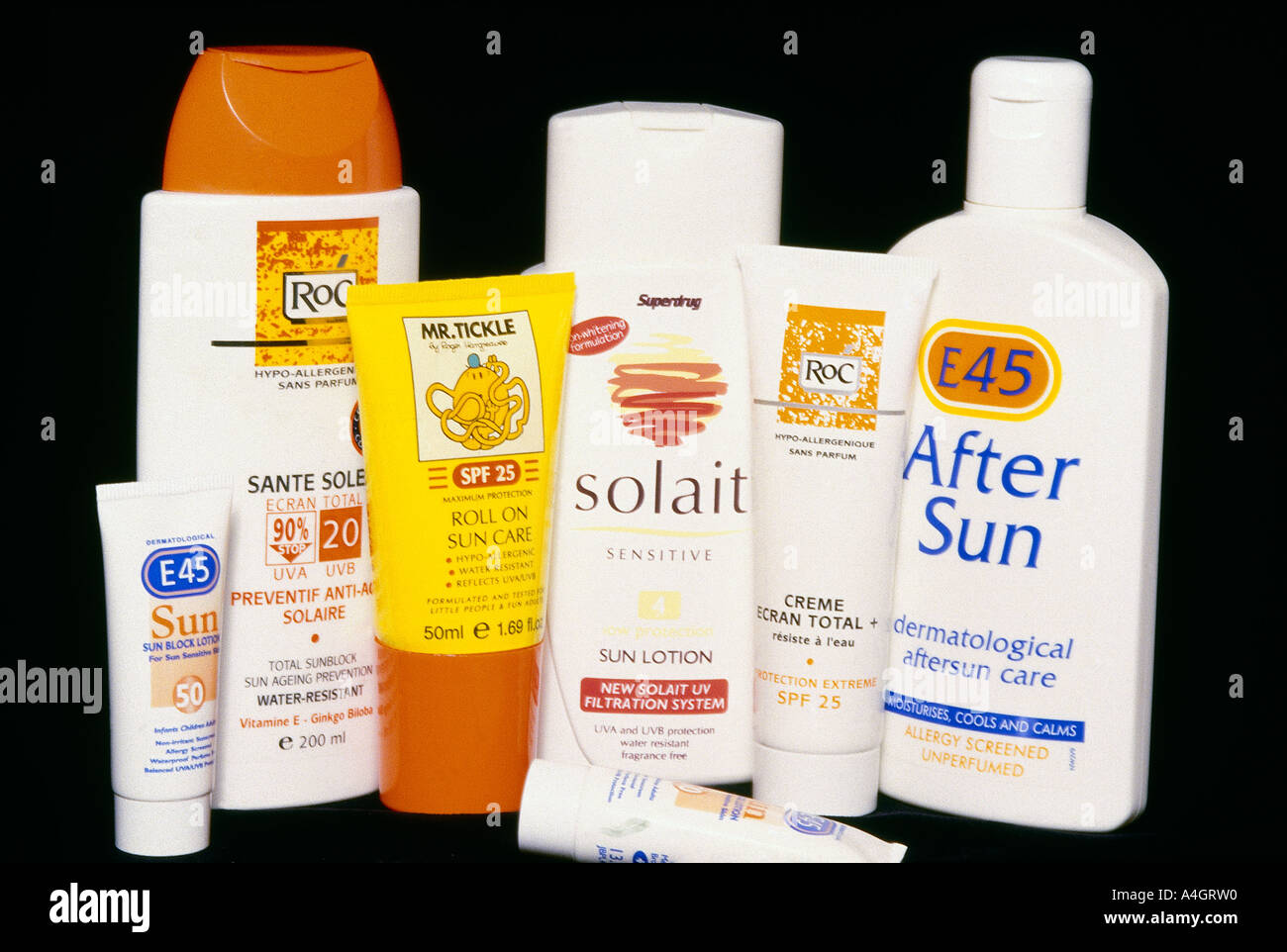 A photograph showing sun protection and after sun creams. - Stock Image