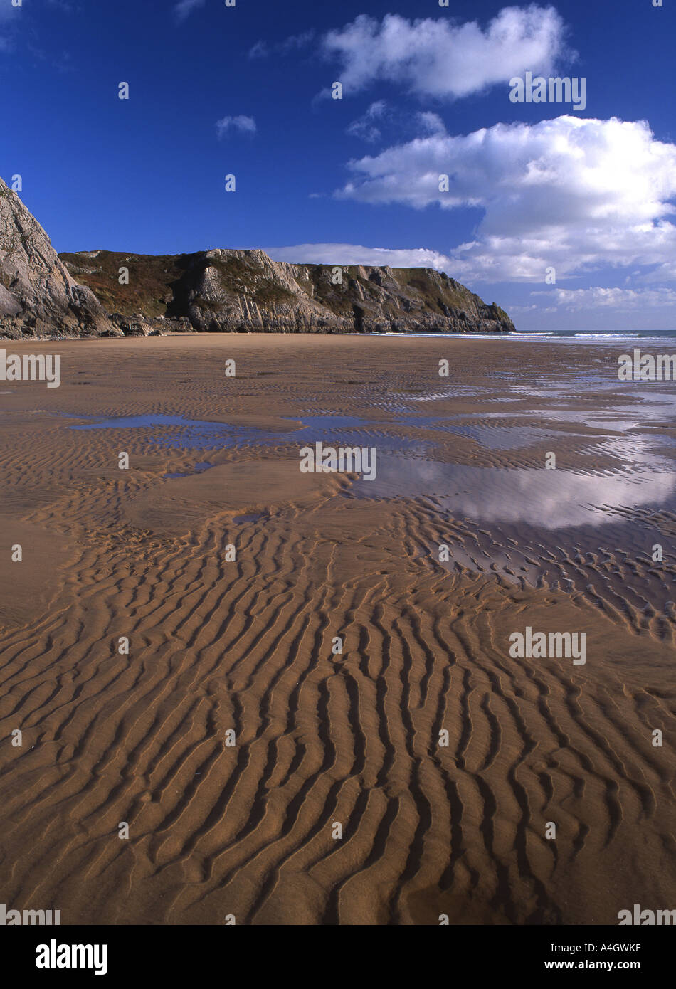 Three Cliffs Bay View towards Pobbles Bay Ripples in sand Gower Peninsula South Wales UK - Stock Image