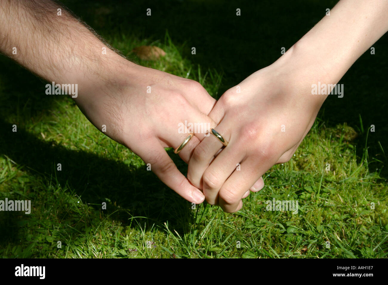 true love and togetherness man and woman holding hands with