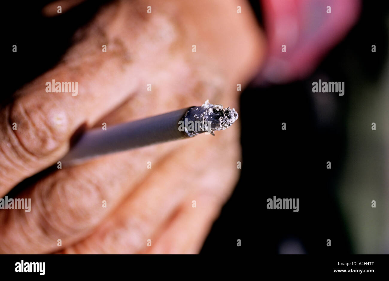 cigarette smoker close up macro wrinkles   50  60 - Stock Image