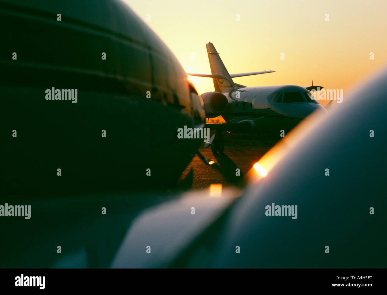 Private Jet Aircraft At Sunset, - Stock Image