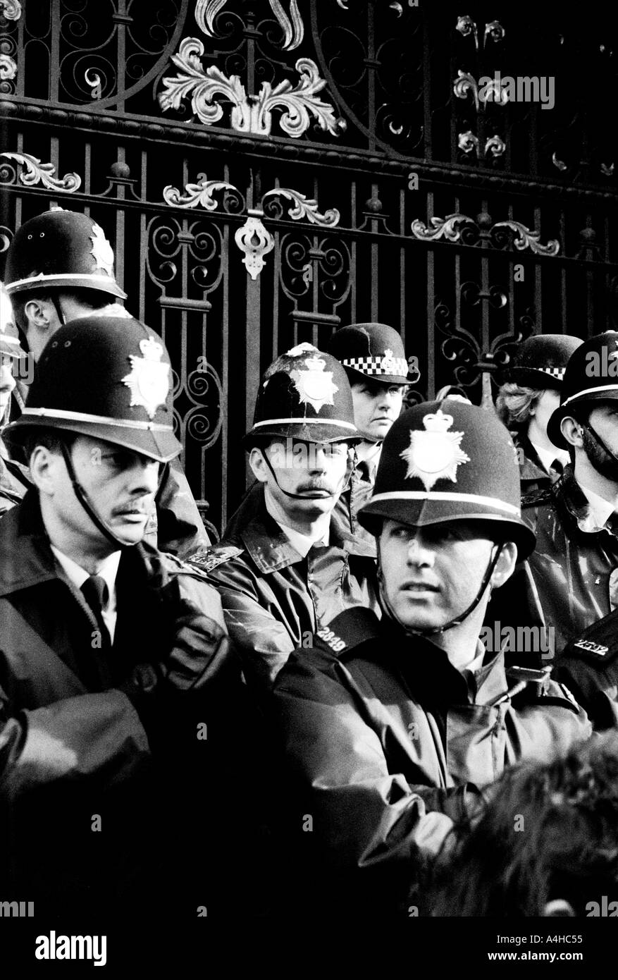 monochrome of a group of police officers protecting sheffield town hall during the poll tax riots 1990 their uniforms = stained - Stock Image