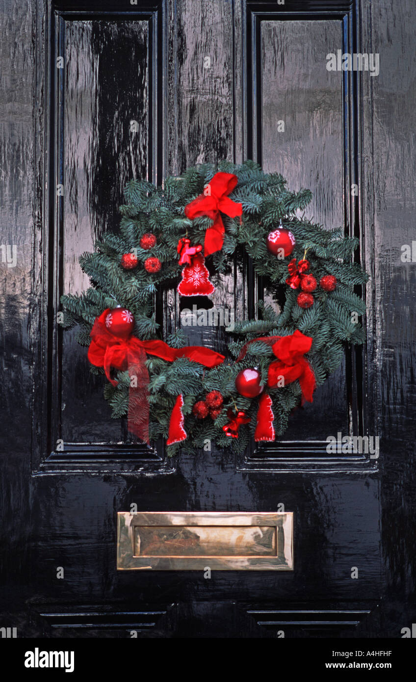 Christmas wreath on a door of a house in Chelsea Royal Borough of Kensington and Chelsea London England United Kingdom - Stock Image