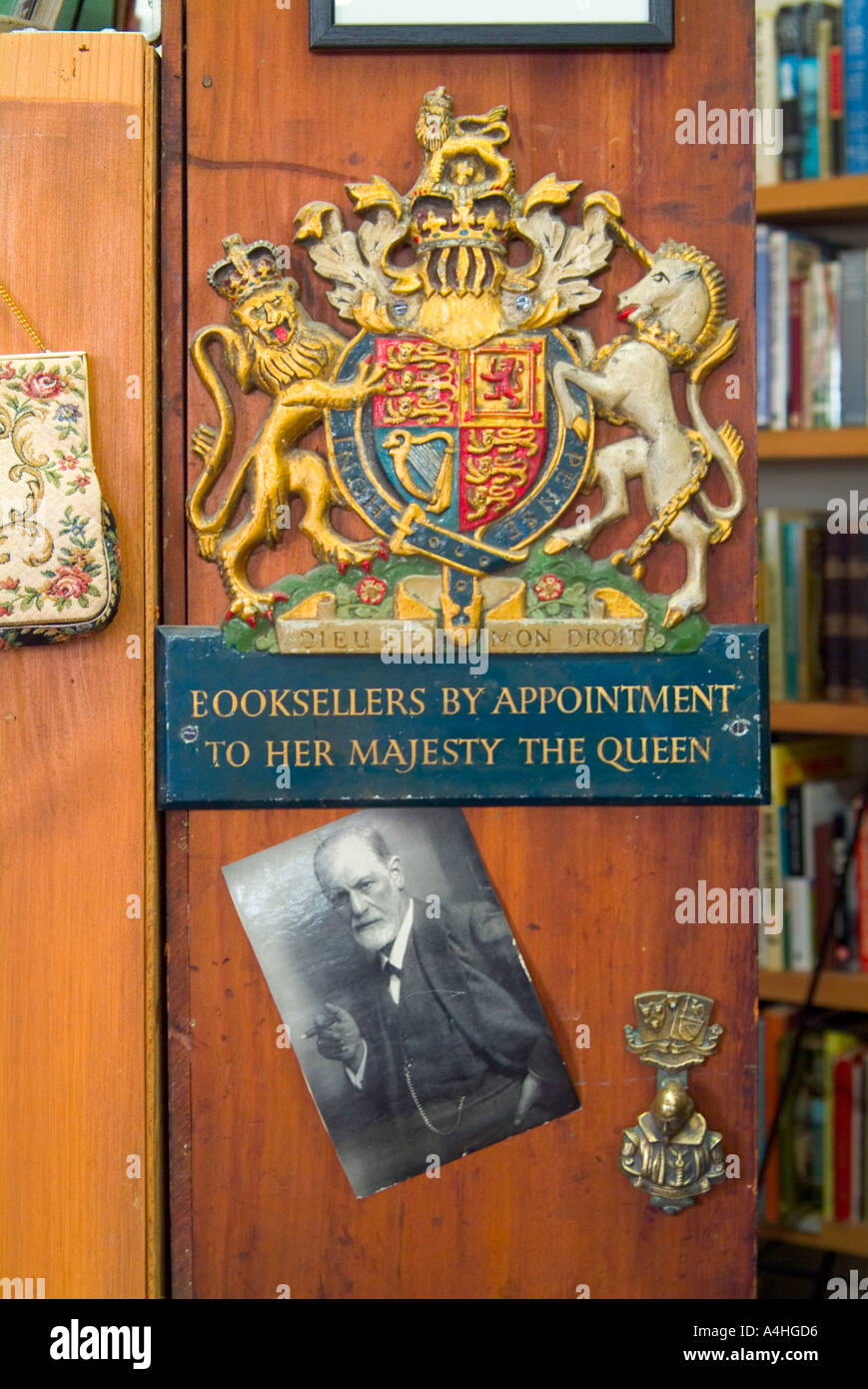 By appointment Royal warrant coat of arms and portrait of Sigmund Freud in secondhand bookshop - Stock Image