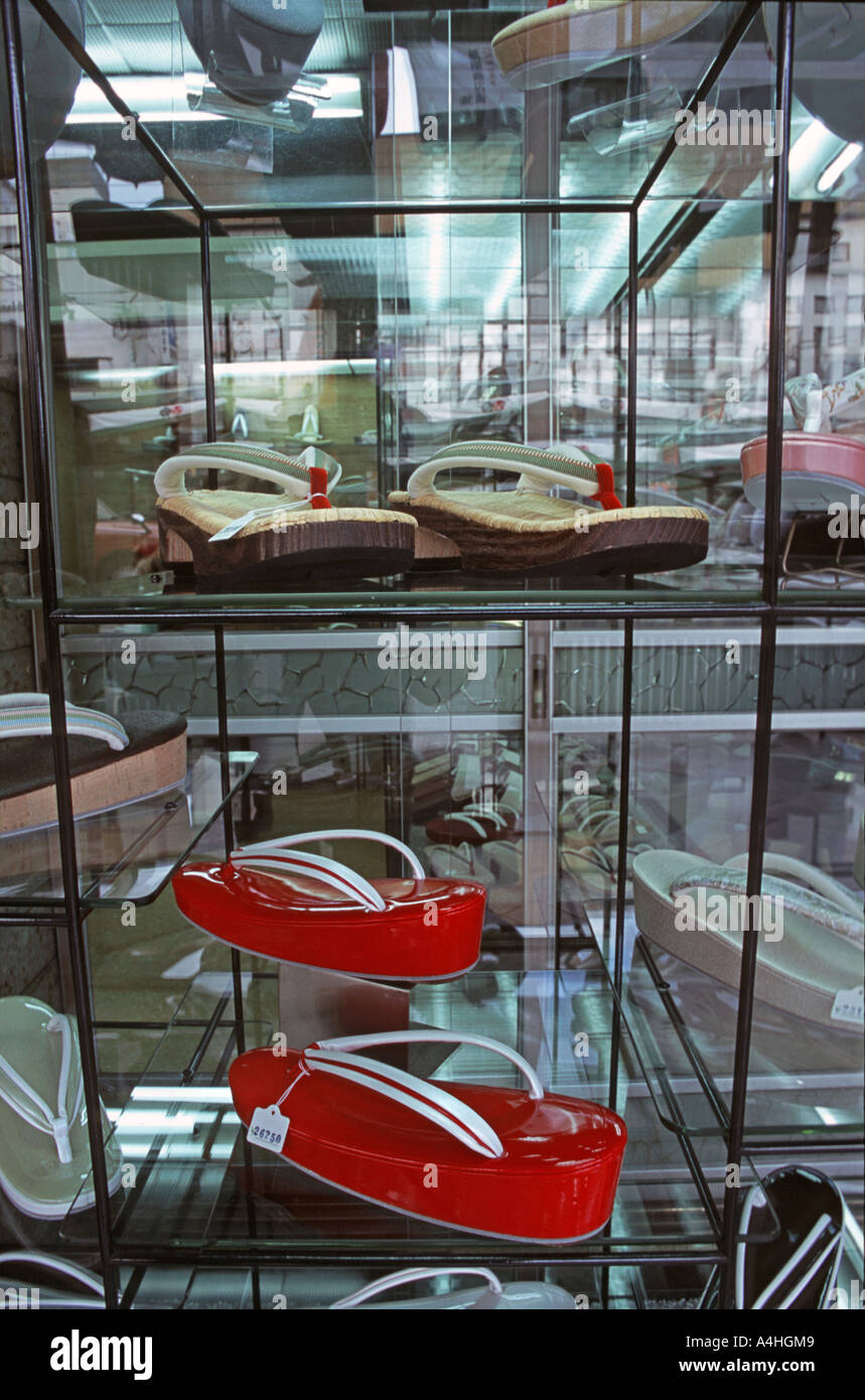 Selection of traditional Japanese womens footwear in a window display of a Kyoto shop Japan - Stock Image