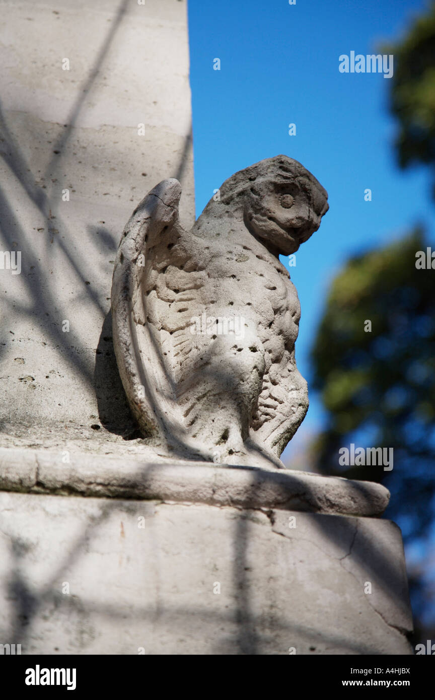 mythical creature depicted in stone in a monument at Pierre lachaise cemetery, Paris. - Stock Image