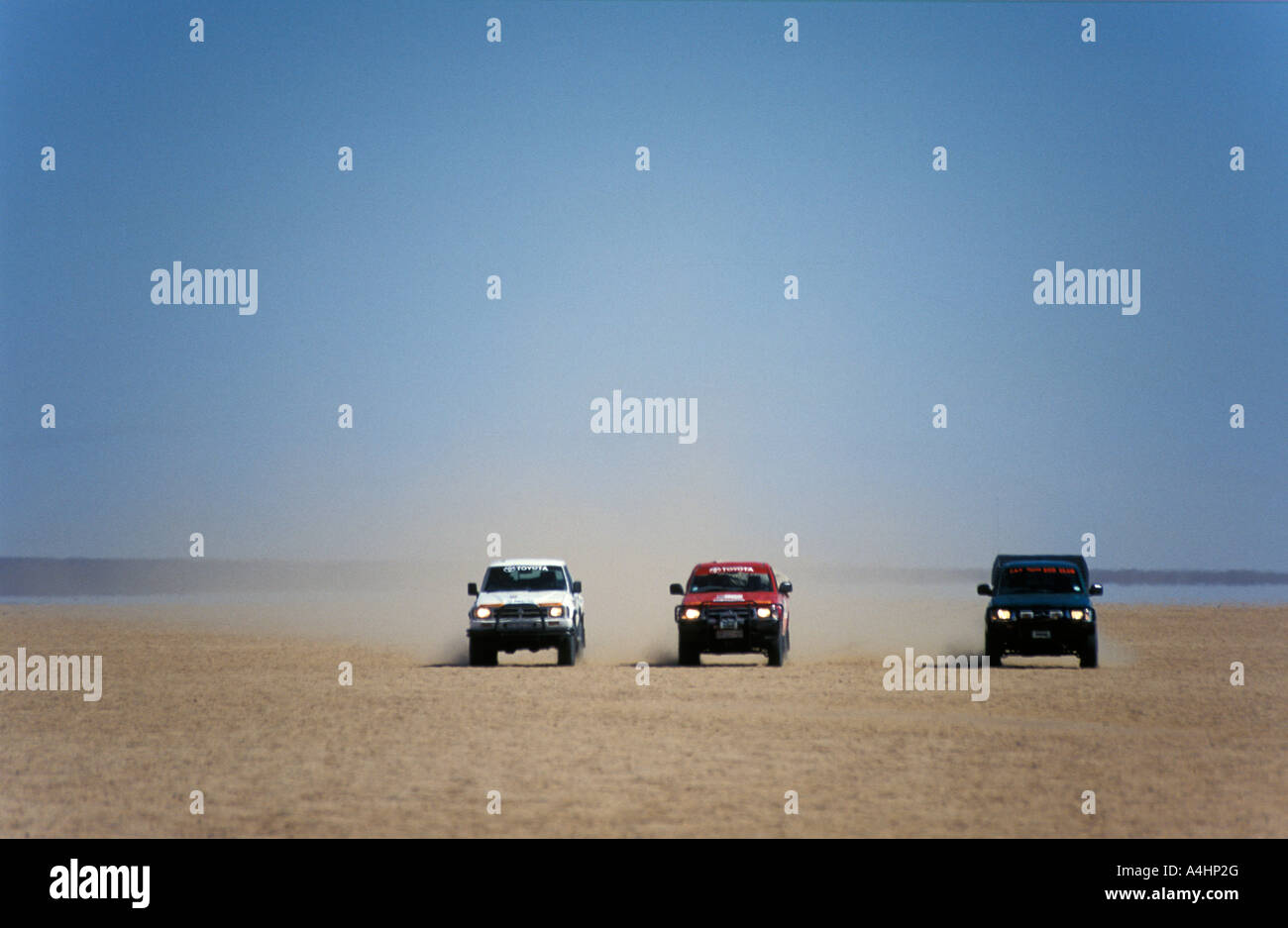 4x4 driving on Sout pan 500ha of crystallised salt Northern Cape South Africa - Stock Image