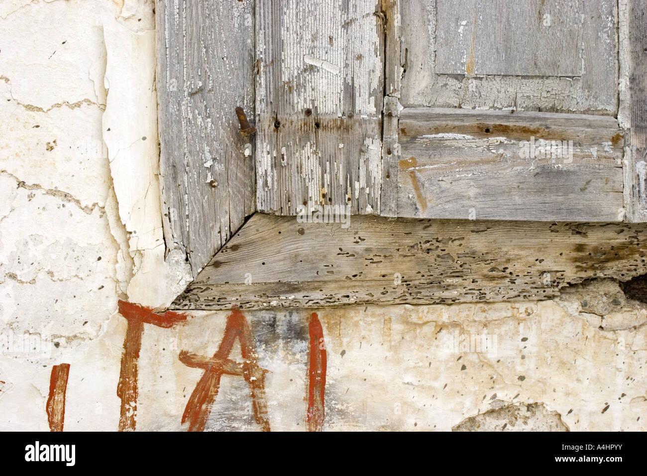 Window with closed shutter on the greek island Samos. - Stock Image
