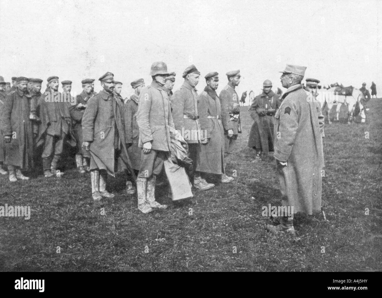 German prisoners taken on 18 April 1918 being told the rules of their captivity, France. Artist: Unknown Stock Photo