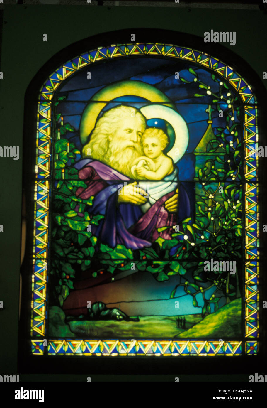 Louis Comfort Tiffany art work Father Christmas Christmas Eve stained glass window Stock Photo