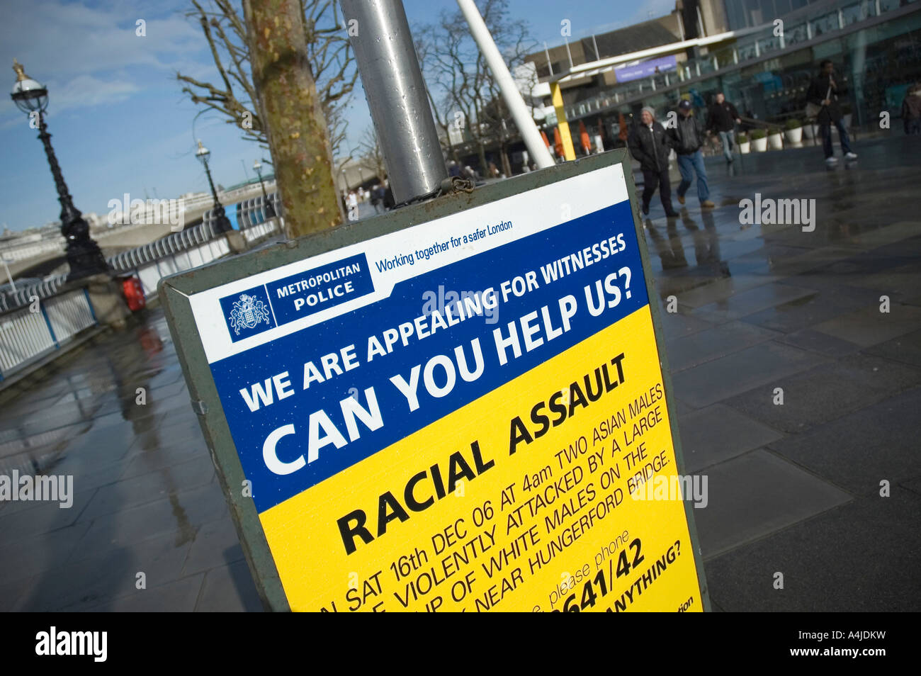 Sign for a racial assault on the South Bank, London, UK - Stock Image