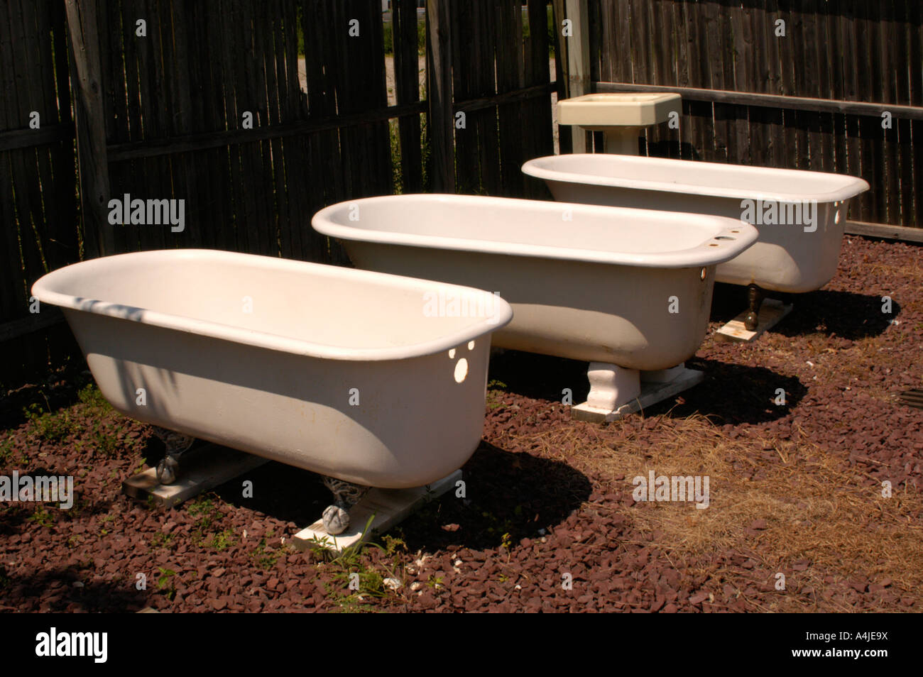 Three bathtubs outside Stock Photo: 11062357 - Alamy