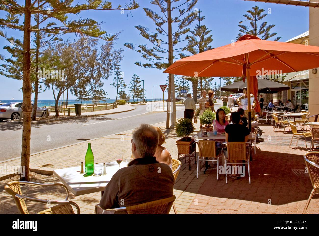 Enjoying lunch in a beach side cafe scarborough perth western australia