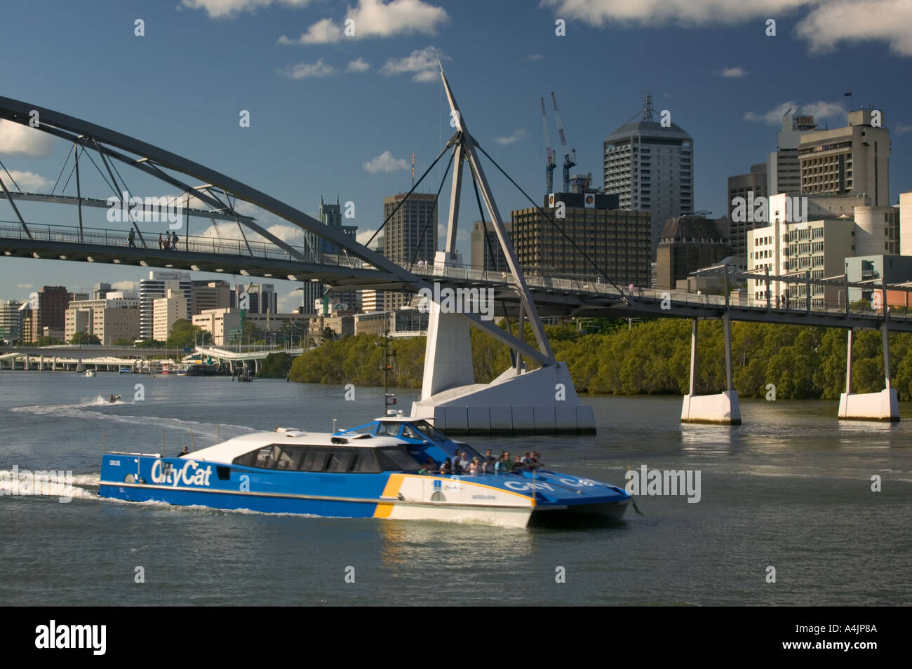 A CityCat catamaran on the Brisbane River with the Goodwill Bridge behind. - Stock Image