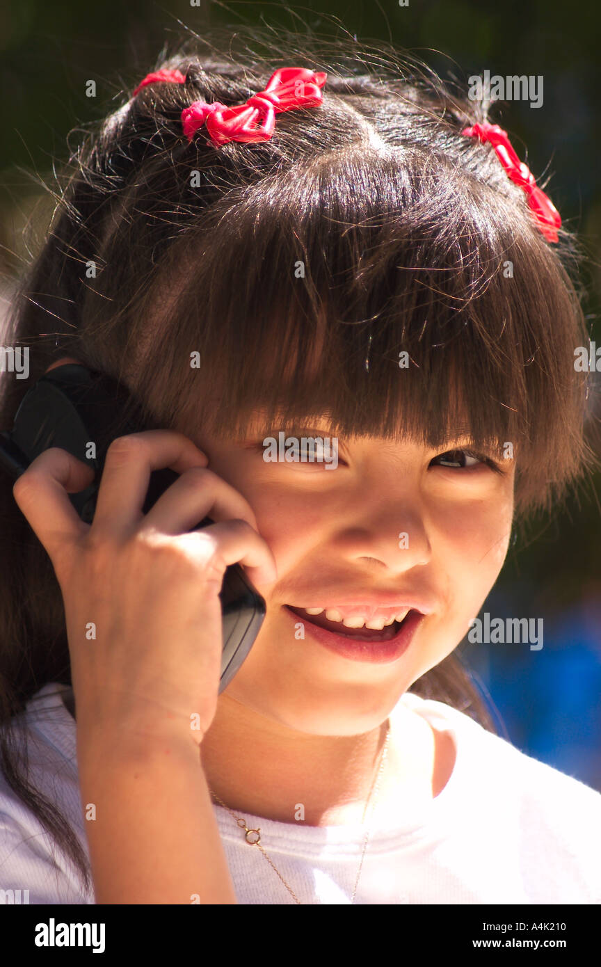 Hispanic young girl talking on phone - Stock Image
