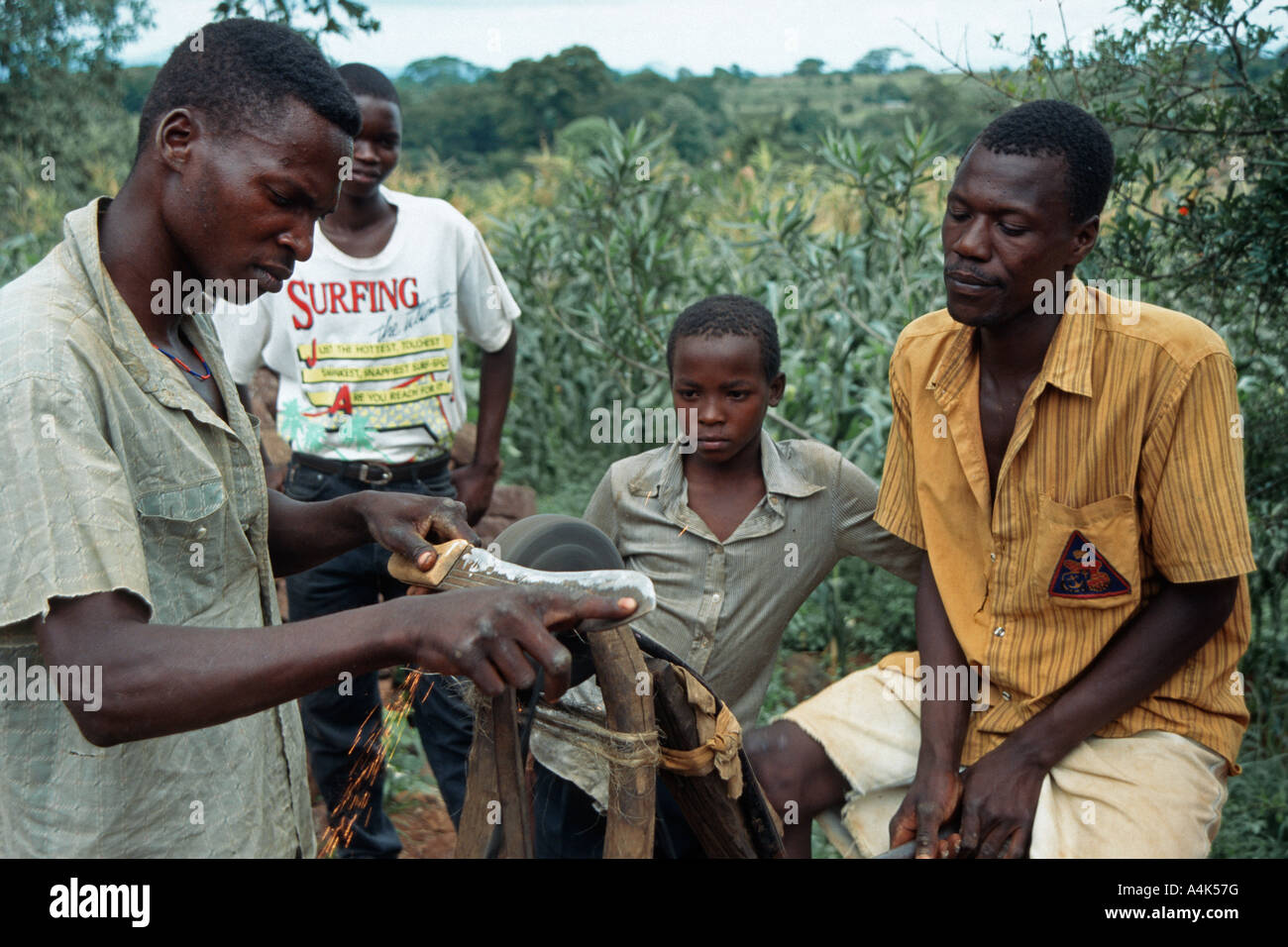 Knife grinder using a converted bicycle to power a grind stone, Himo, Tanzania - Stock Image