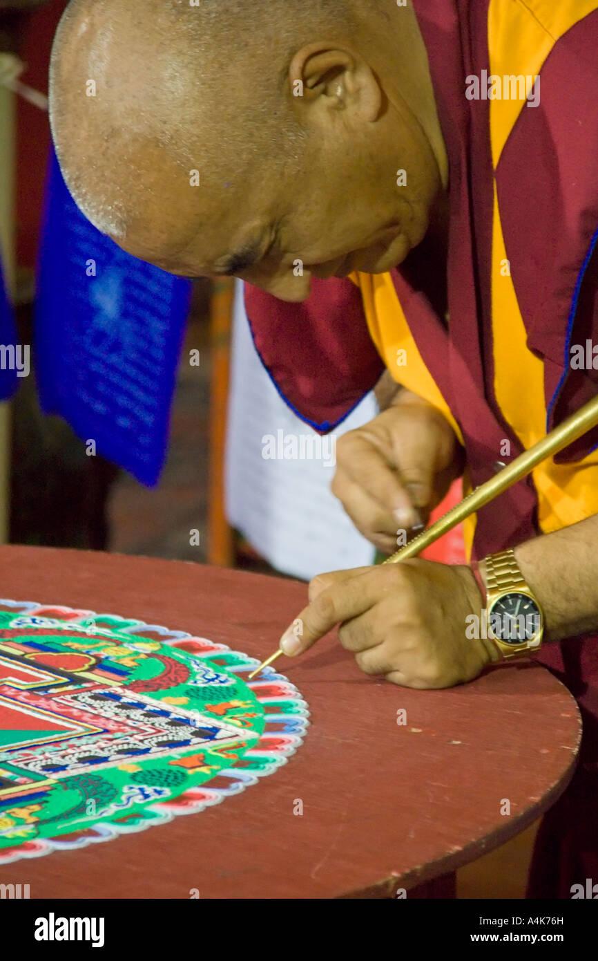 A tibetan monk drawing a mandala inside the Vincennes pagoda - Paris, France - Stock Image