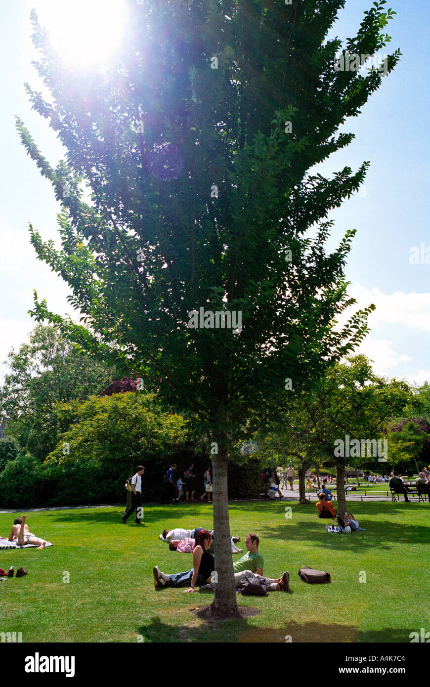 On a hot summer day St Stephens Green in the center of Dublin, Ireland is a place to relax and cool off - Stock Image