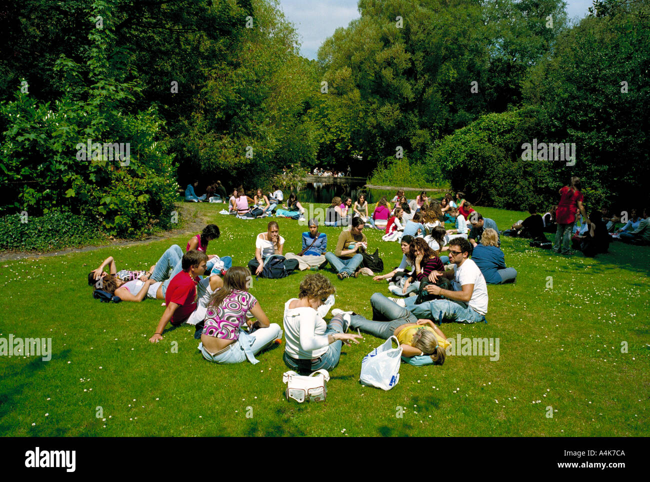 On a hot summer day students head to St Stephens Green in the center of Dublin, Ireland for a place to relax and cool off - Stock Image