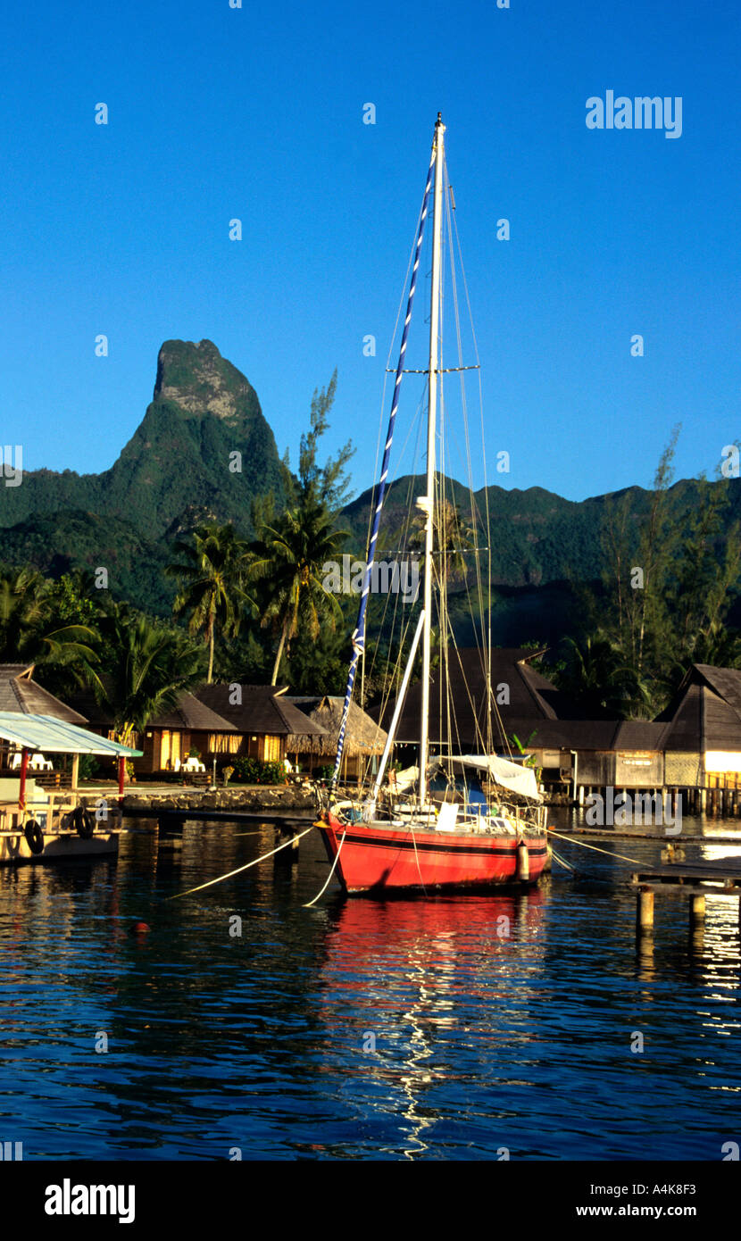 Red Yacht at anchor in the beautiful Cook s Bay on Moorea Island Tahiti French Polynesia the Friendly Islands South Pacific - Stock Image