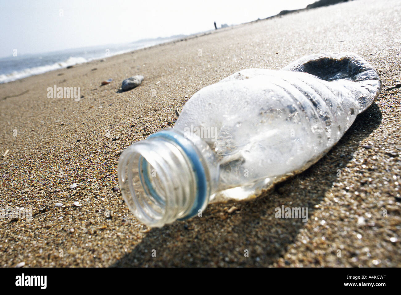 Plastic bottle on beach - Stock Image
