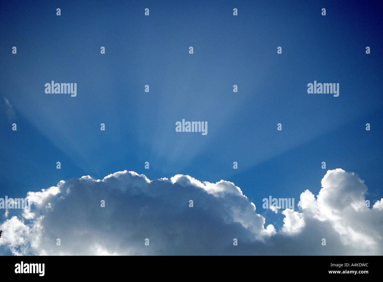 Cumulus cloud backlit by sun - Stock Image