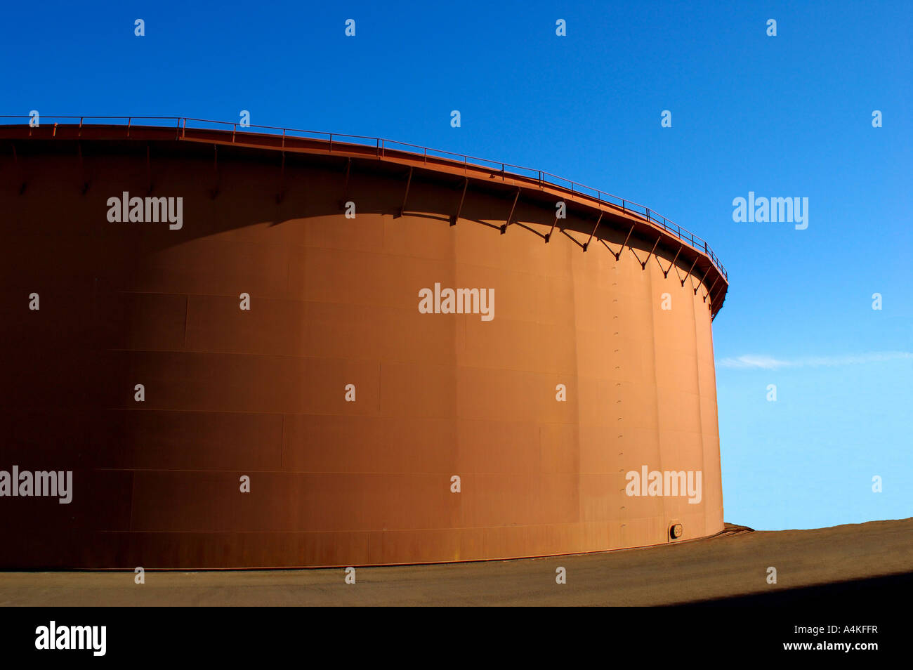 Oil Tank #1: brown oil tank, late afternoon - Stock Image