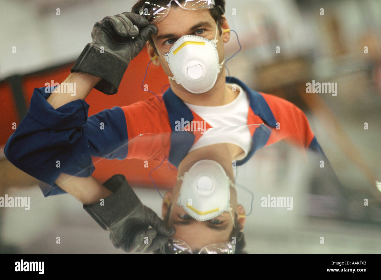 Manual worker wearing protective gear - Stock Image