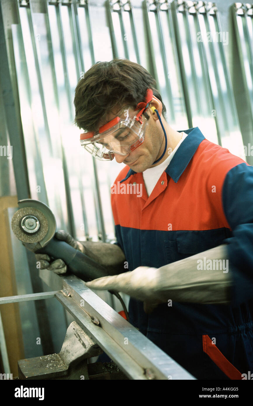 Manual worker sanding - Stock Image