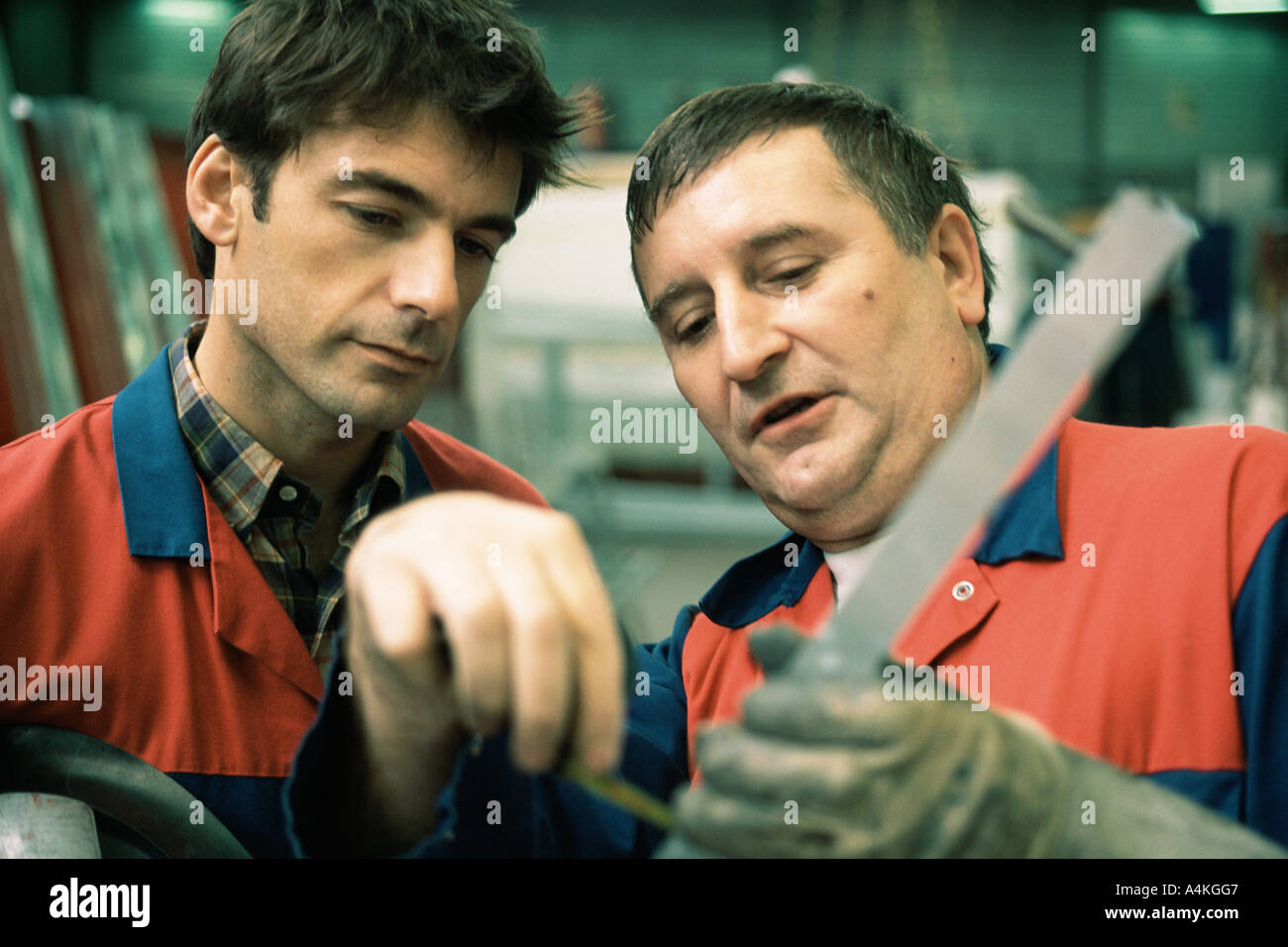 Manual and apprentice - Stock Image