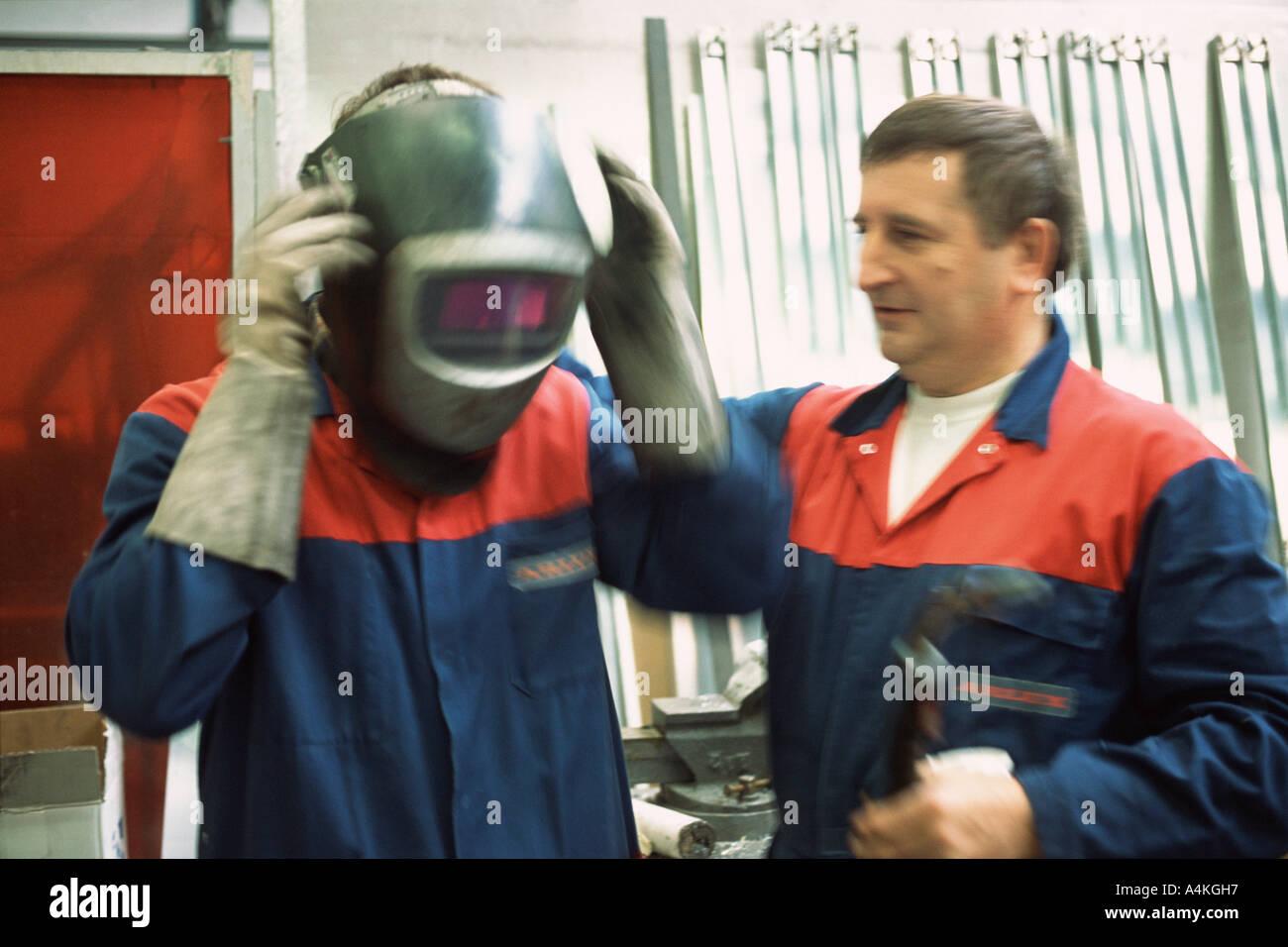 Welder and apprentice - Stock Image