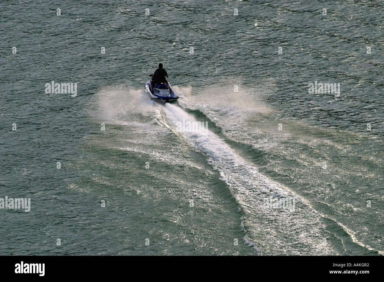 Person riding jetski, high angle view Stock Photo