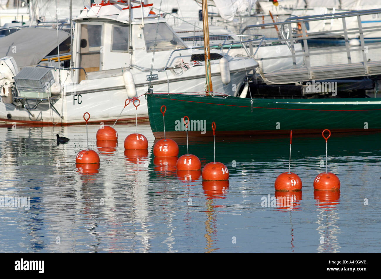 Moored boats and buoys - Stock Image