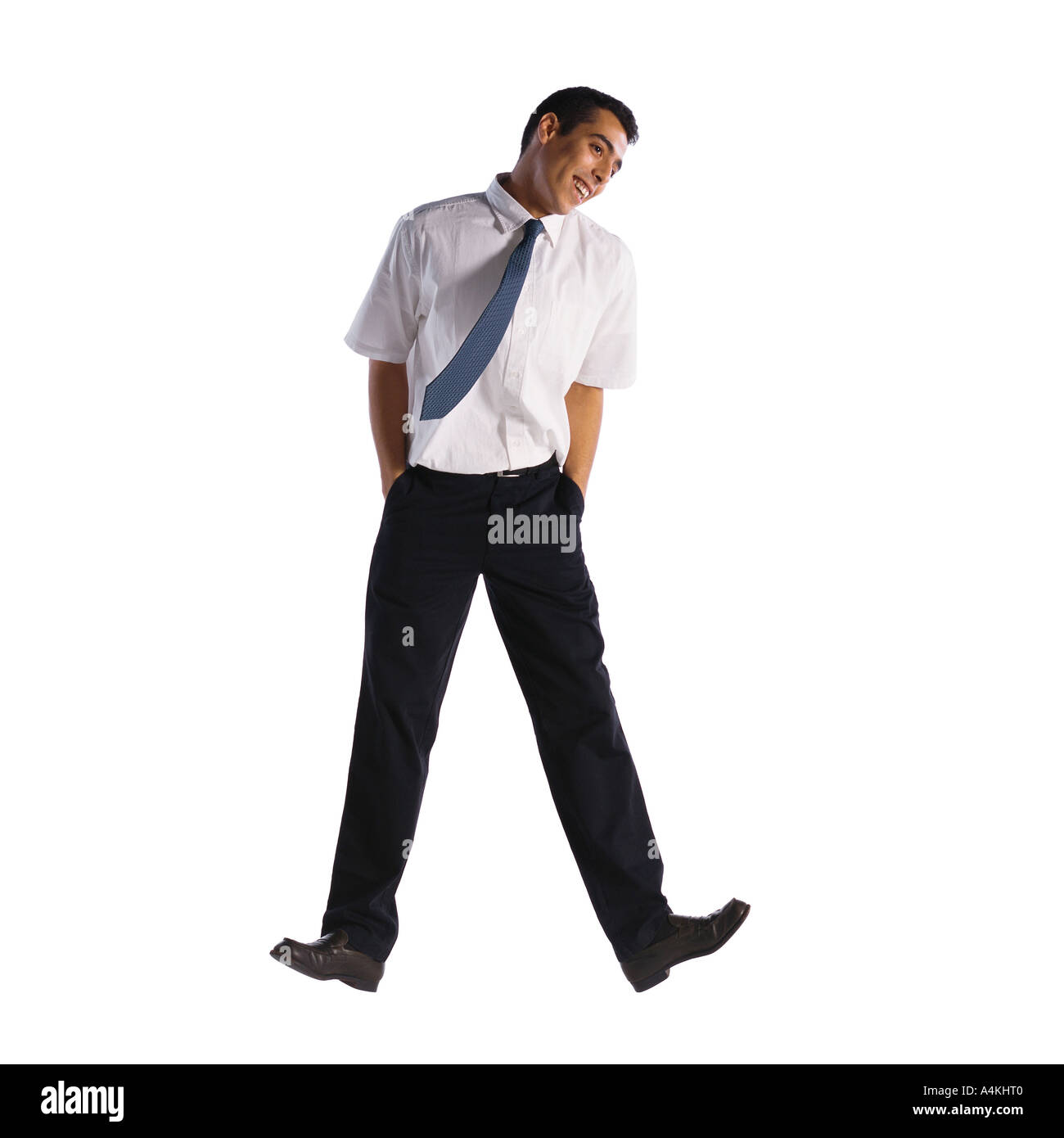 Man jumping with hands in pockets - Stock Image