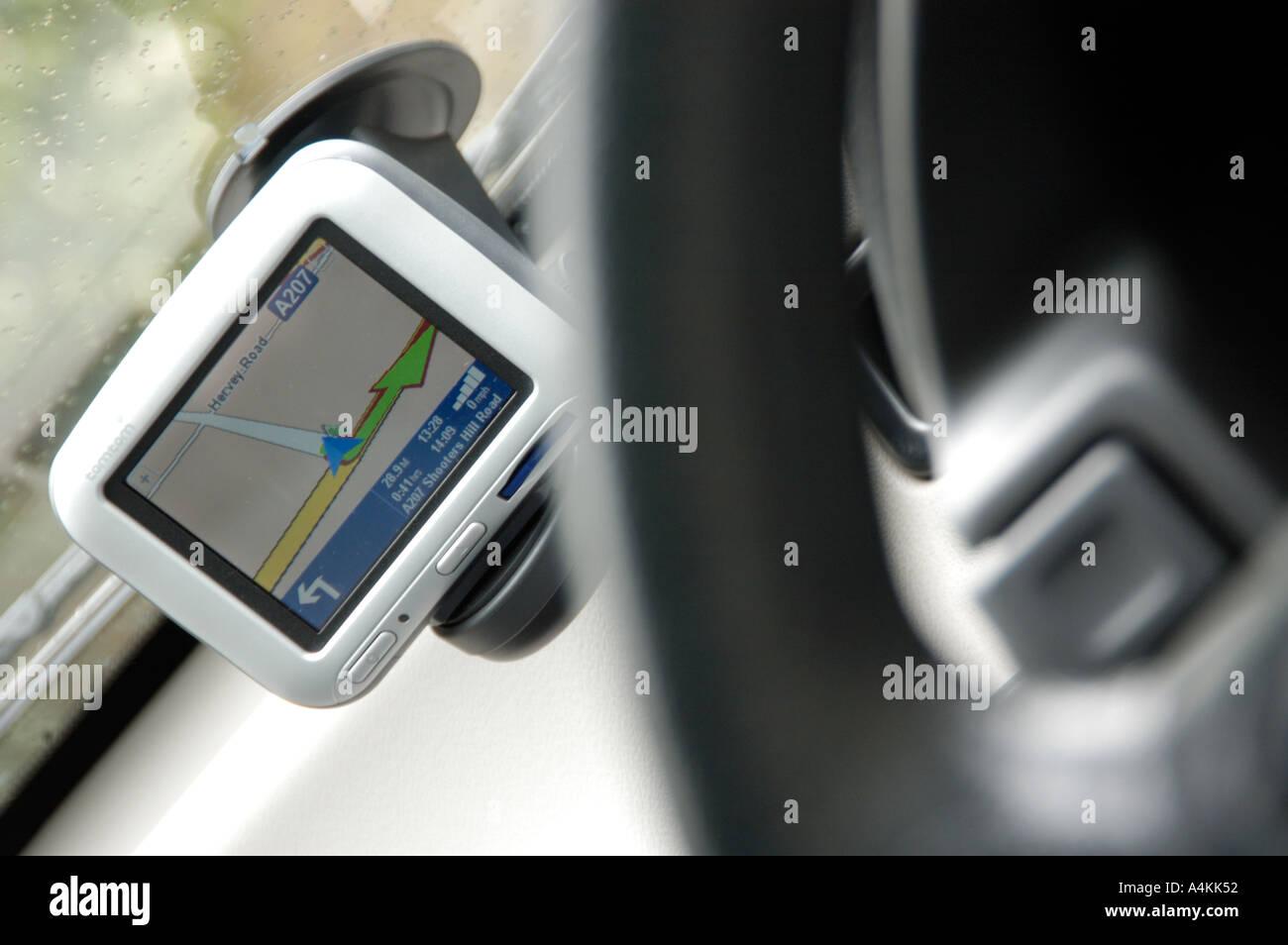 Satellite navigation on a car dashboard - Stock Image