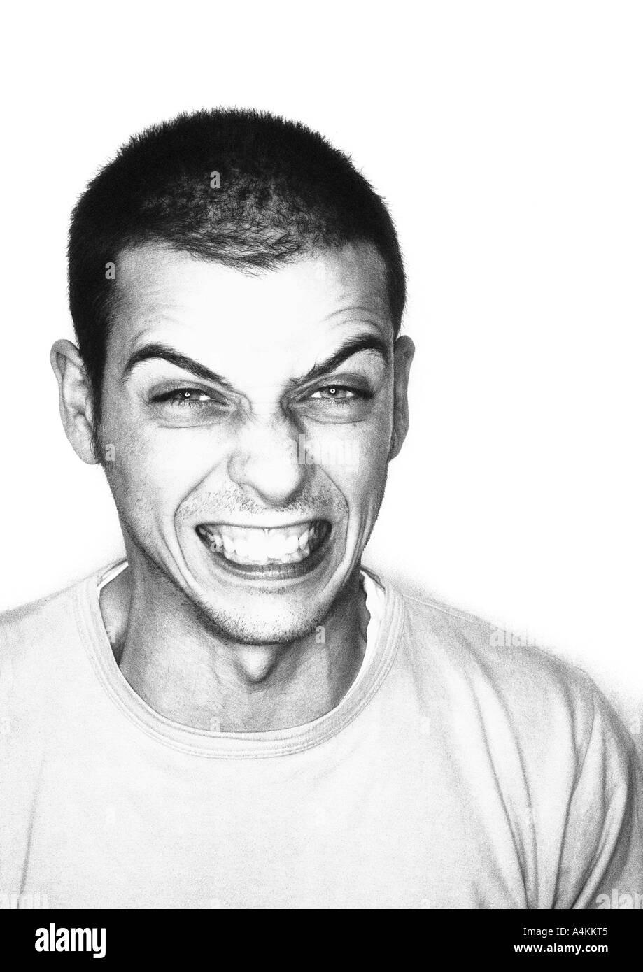 Man grimacing, portrait - Stock Image