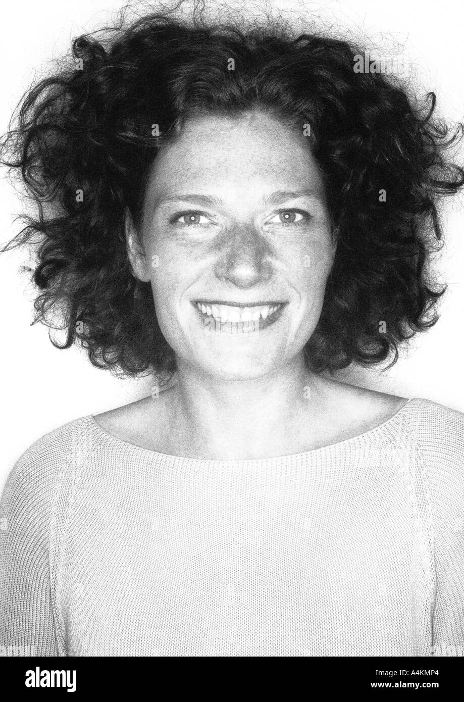 Woman smiling, portrait, b&w. - Stock Image