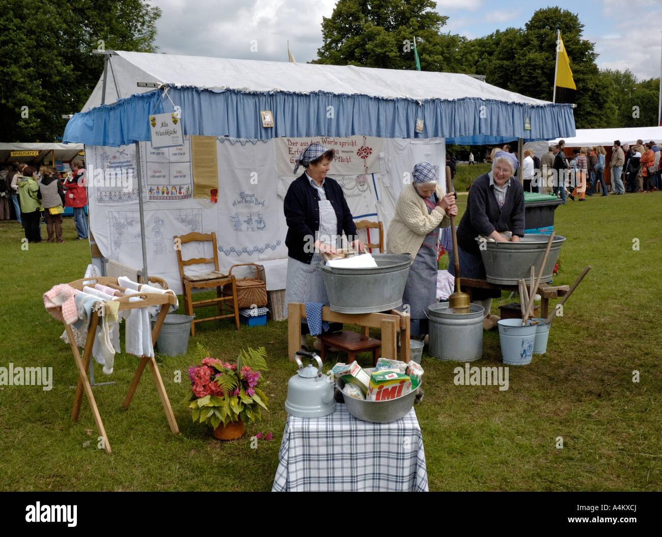 Krefeld, Germany. Flachsmarkt at Burg Linn, 2006. Washing by hand demonstration. - Stock Image